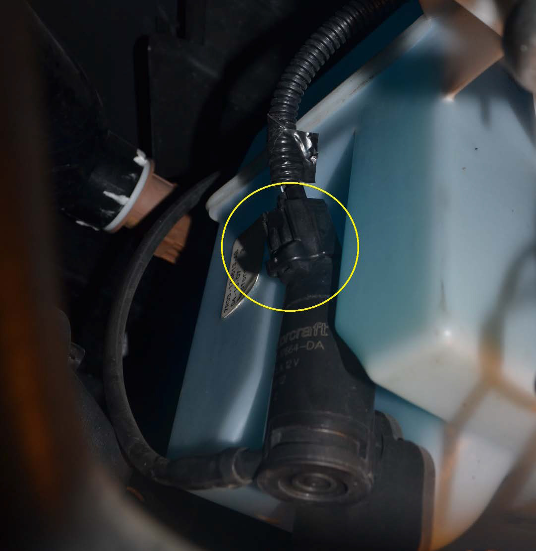 windshield washer reservoir location