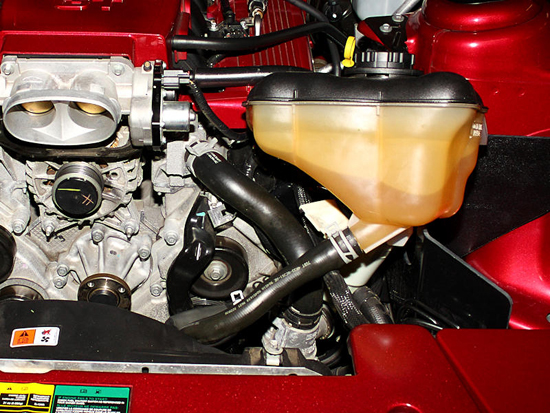 Reposition Coolant Tank
